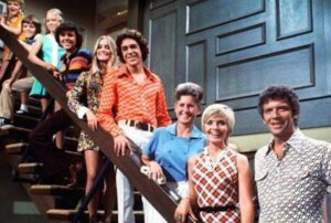 Which Character Appears in The Upper Right Corner During the Opening Credits of the Brady Bunch?